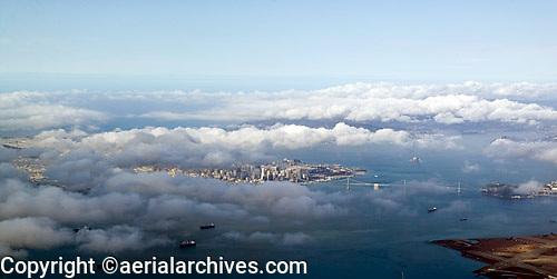 aerial photograph as fog burns off San Francisco skyline