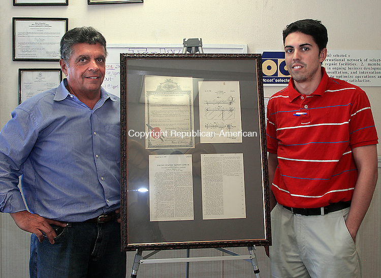 WATERBURY, CT -25 JULY 2008 -072508DA05- Owner of Durable Radiator and Auto Body in Waterbury, David Geremia, left, of Morris, and his son, Rich, of Southington stand next to a display holding a patent for the first automatic windshield wipers that was invented by David's grandfather, Alexander M. Geremia. <br /> Darlene Douty/Republican-American