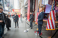 Tourists pose for photographs with a wax figure of President Donald Trump in front of Madame Tussaud's Wax Museum in Times Square after the inauguration of Trump as the 45th president of the United States on Friday, January 20, 2017.   (© Richard B. Levine)