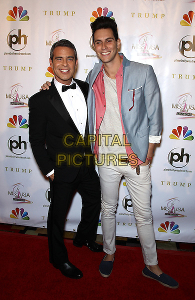 Andy Cohen, Gabe Saporta.2012 Miss USA Pageant red carpet arrivals at Planet Hollywood Resort and Casino, Las Vegas, Nevada, USA..3rd June 2012.full length black tuxedo blue jacket looking up funny white pink smiling crouching tall short .CAP/ADM/MJT.© MJT/AdMedia/Capital Pictures.