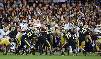 Purdue Boilermakers kicker Paul Griggs (37) misses a first quarter field goal attempt.