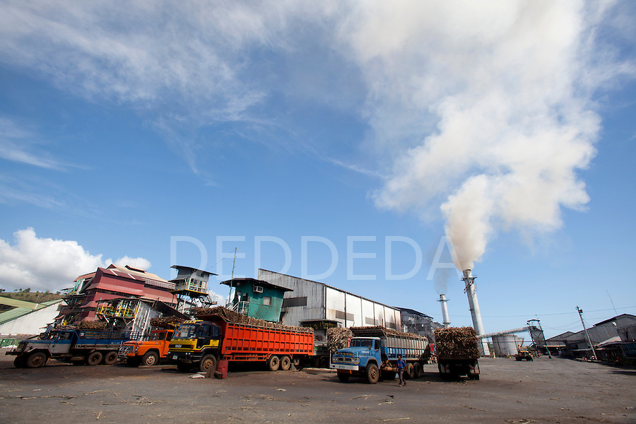 Large trucks loaded with sugar cane is weighed at the URSUMCO (Universal Robina Sugar Milling Corporation) cane sugar mill near Bias City on Negros Island, Philippines.