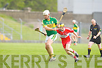 Kerry's Gary O'Brien and Derry's John McCloskey in action in the Christy Ring Cup on Saturday.