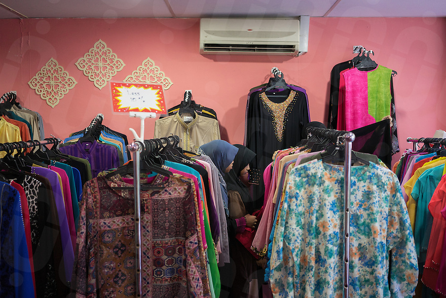 January 10, 2015 - Rawang (Malaysia). Young members of the organisation buys clothes in one of the company's shop. The enterprise, which employs 4,000 people worldwide through its complicated network of subsidiaries, operates restaurants, clothing shops, noodle factories and health clinics - just to name a few. It also runs its own schools, care homes and rehabilitation centres. © Thomas Cristofoletti / Ruom