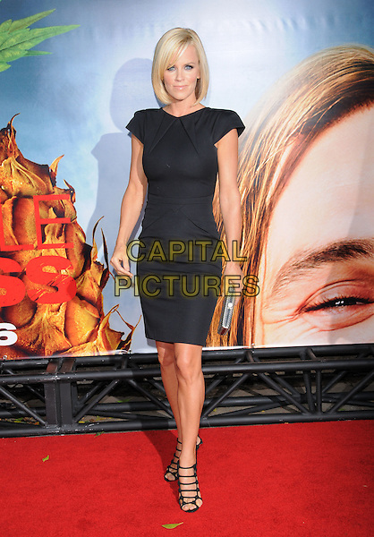 """JENNY McCARTHY.The Columbia Pictures' World Premiere of """"Pineapple Express"""" held at The Mann's Village Theatre in Westwood, California on .July 31st, 2008 .full length black dress silver strappy sandals silver clutch bag .CAP/DVS.©Debbie VanStory/Capital Pictures."""