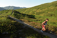 An ultramarathon runner traverses a ridge on the Resurrection Pass Trail during the 2004 Resurrection Pass Trail 100-Miler and 50-Miler races. Racers make their way through the Kenai Mountains and the Chugach National Forest between Cooper Landing and Hope, Alaska.