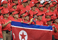 North Korea fans cheer on their team during their first round game. The United States (USA) and North Korea (PRK) played to a 2-2 tie during a FIFA Women's World Cup China 2007 opening round Group B match at Chengdu Sports Center Stadium, Chengdu, China, on September 11, 2007.
