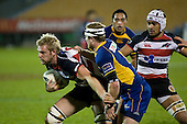 Andrew Van der Heijden tries to fight off the tackle of Toby Morland. Air New Zealand Cup rugby game played at Mt Smart Stadium, Auckland, between Counties Manukau Steelers & Otago on Thursday August 21st 2008..Otago won 22 - 8 after leading 12 - 8 at halftime.