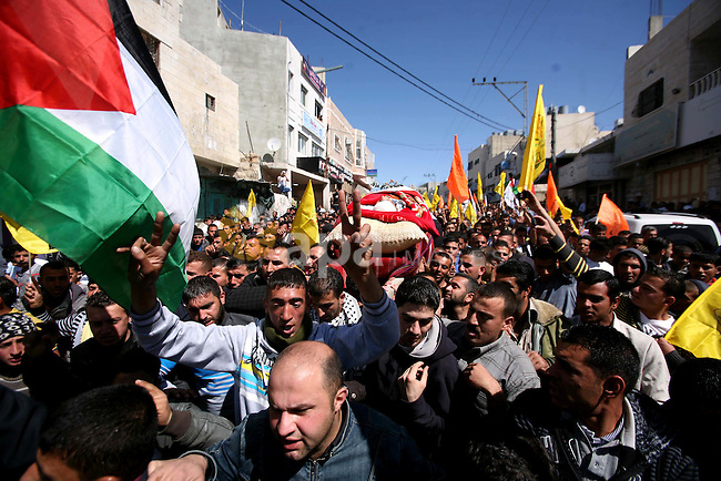 Palestinians carry the body of Zakariya Abu Eram during his funeral in the West Bank town of Yatta, near Hebron, Friday, March 9, 2012. According to the Israeli military, a Palestinian stabbed an Israeli soldier in the neck during a raid in the town of Yatta, seriously wounding him. The soldier opened fire, wounding the assailant and killing another man who was not involved in the attack, witnesses said. Photo by Mamoun Wazwaz