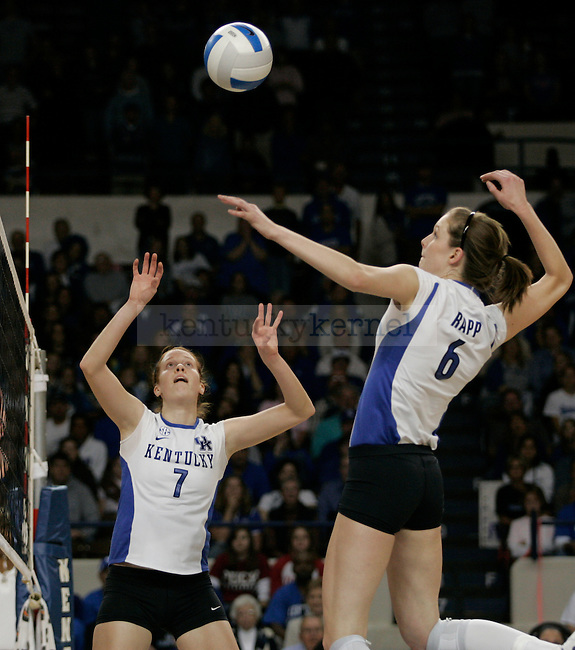 Middle blocker Lauren Rapp hits the ball after Sarah Rumley sets it during the UK volleyball game against Florida at Memorial Coliseum on Sunday, Nov. 22, 2009. No. 10 UK lost to No. 13 Florida (3-1). Photo by Adam Wolffbrandt | Staff