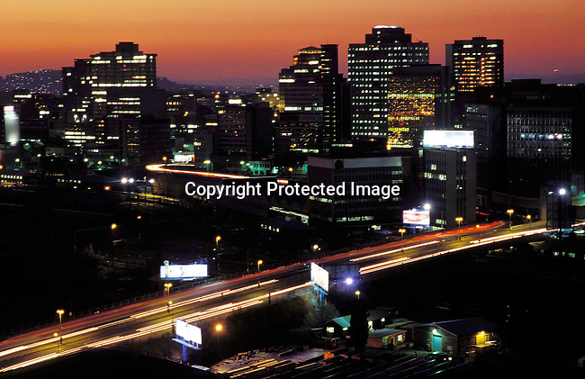 digajhb00137.Gauteng. A view of the skyline in downtown Johannesburg as sunset on June 20, 2002 in Johannesburg, South Africa. The city is the melting pot for Africans arriving to South Africa with it's mix of people, culture and diversity..©Per-Anders Pettersson/iAfrika Photos