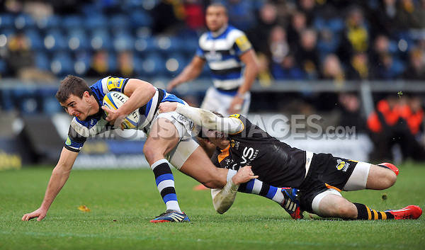 Ollie Devoto is tackled by Elliot Daly. Aviva Premiership match, between London Wasps and Bath Rugby on November 24, 2013 at Adams Park in High Wycombe, England. Photo by: Patrick Khachfe / Onside Images
