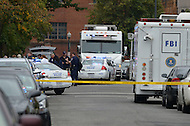 September 16, 2013  (Washington, DC)  Metropolitan Police and FBI agents secure an entrance to the Washington Navy Yard after gunman Aaron Alexis shot and killed 12 people September 16, 2013.  (Photo by Don Baxter/Media Images International)