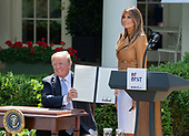 United States President Donald J. Trump holds a proclamation he signed after First Lady Melania Trump announced her Initiatives in the Rose Garden of the White <br /> House in Washington, DC on Monday, May 7, 2018.<br /> Credit: Ron Sachs / CNP<br /> (RESTRICTION: NO New York or New Jersey Newspapers or newspapers within a 75 mile radius of New York City)