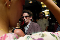 NEW YORK--SEP 11 Rolling Stones guitar player Keith Richards looks at model Karolina Kurkova, left, as he visits backstage after the designer Stephen Burrows fashion show at the Style Lounge during Olympus Fashion Week Spring 2005 in New York City on September 11, 2004. (Photo by Landon Nordeman/Getty Images)