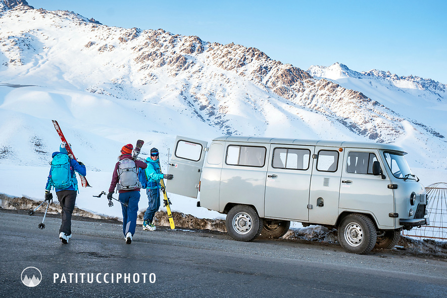 Skiers arrive at their van, a Russian made UAZ 452, while traveling in Kyrgyzstan for a ski trip
