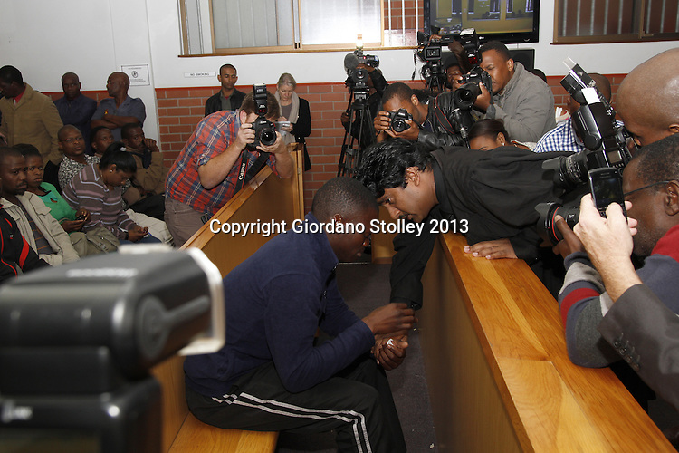 DURBAN - 9 September 2013 - A distraught Sanele Goodness May (seated left), the driver of an articulated lorry that crashed into four minibus taxis and a car killing 22 people, talks to his lawyer in the full glare of the media  the Pinetown Magistrates Court. Sanele's lawyer Theasan Pillay was appointed by Sagekal Logistics, the company that owned the lorry he was driving. May faces 22 murder charges. Picture: Allied Picture Press/APP