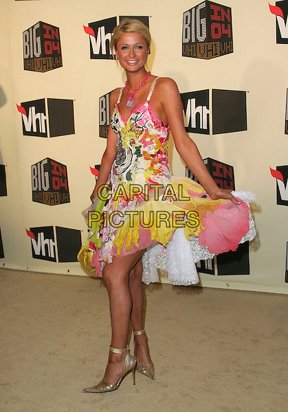 PARIS HILTON.The VH1 Big in 04  Award Show held at The Shrine Auditorium in Los Angeles, California .December 1, 2004.full length, fashion disaster, feet, multi coloured, layered ruffled dress.www.capitalpictures.com.sales@capitalpictures.com.Supplied by Capital Pictures