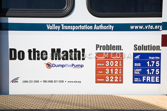 Mass transit promotional advertising on a side of a VTA  light rail car comparing the cost of ridership to gas prices in 2007. The advertisement shows the slogan 'DO THE MATH, DUMP THE PUMP'. Mountain View, California, USA