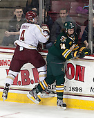 Teddy Doherty (BC - 4), Anthony DeCenzo (UVM - 14) - The Boston College Eagles defeated the University of Vermont Catamounts 4-1 on Friday, February 1, 2013, at Kelley Rink in Conte Forum in Chestnut Hill, Massachusetts.