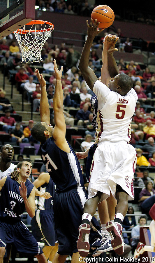 TALLAHASSEE, FL 11/12/10-FSU-ASU MBB 111210 CH-Florida State's Bernard James shoots over North Florida's Andres Diaz during first half action Friday at the Donald L. Tucker Center in Tallahassee. .COLIN HACKLEY PHOTO
