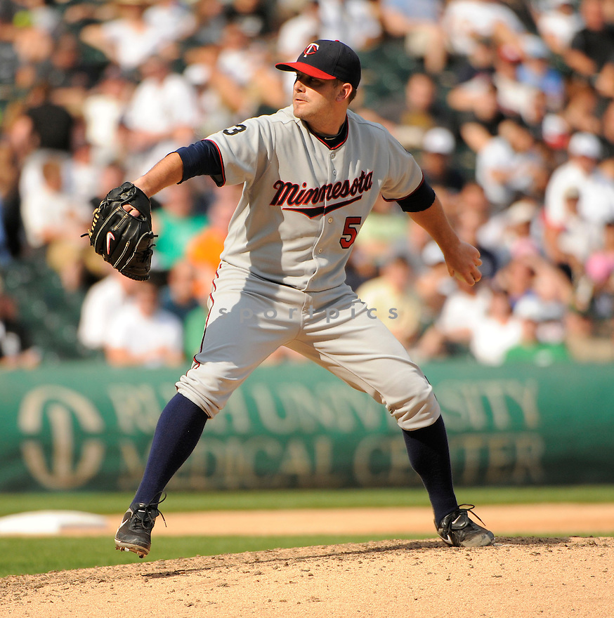 BRIAN DUENSING, of the Minnesota Twins, in action during the Twins game against the Chicago White Sox on July 9, 2011 at US Cellular Field in Chicago, Illinois. The White Sox beat the Twins 4-3.