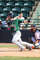 Jeremy Sy (25) of the Augusta GreenJackets follows through on his swing against the Hickory Crawdads at L.P. Frans Stadium on May 11, 2014 in Hickory, North Carolina.  The GreenJackets defeated the Crawdads 9-4.  (Brian Westerholt/Four Seam Images)