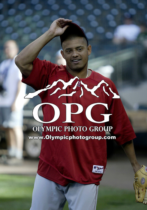 01 August 2007:   Los Angeles Angels Orlando Cabrera warms up before the game at Safeco Field against the Seattle Mariners. Seattle won 8-7 in 12 innings.