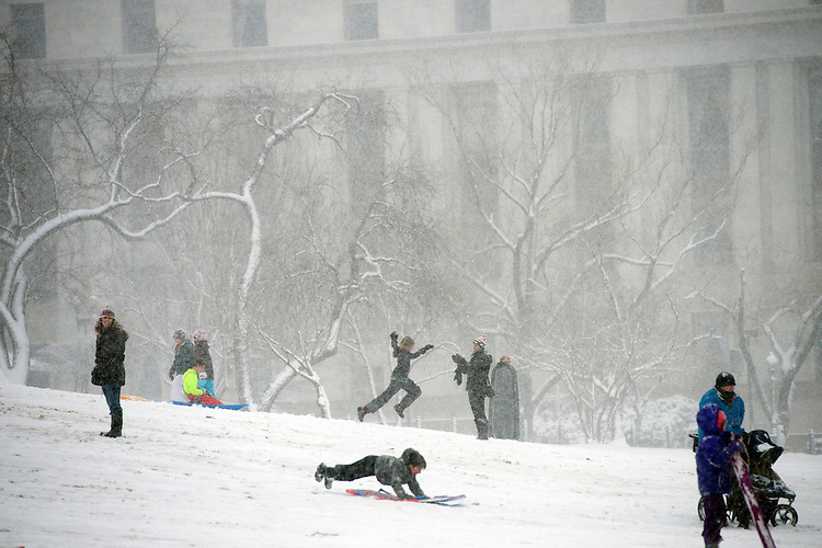 UNITED STATES - MARCH 05: Sledders slide down the west front lawn of the Capitol during a snow storm, March 5, 2015. The Capitol Police informed parents of the ban on sledding in the area but most choose to ignore the warning. (Photo By Tom Williams/CQ Roll Call)