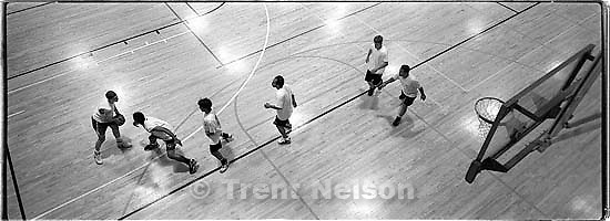 The &quot;4-Bucketeers&quot; take on &quot;Grumpy Old Men&quot; in the Hoop Fest 3-on-3 Basketball Tournament at the Deseret Gym.<br />