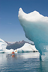 Alaska, Prince William Sound, solo sea kayaker, Columbia Bay, Columbia Glacier, paddling between Icebergs, Brash Ice, USA, David Fox, released,.