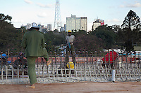 A Chinese supervisor speaking to Kenyan workers on a roads project in Nairobi.