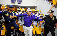 Sept. 5, 2009; Seattle, WA, USA; LSU Tigers head coach Les Miles holds back his players as they prepare to enter the field prior to the game against the Washington Huskies at Husky Stadium. Mandatory Credit: Mark J. Rebilas-