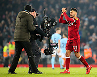 Liverpool's Alex Oxlade-Chamberlain celebrates on the pitch after the match<br /> <br /> Photographer Alex Dodd/CameraSport<br /> <br /> The Premier League - Liverpool v Manchester City - Sunday 14th January 2018 - Anfield - Liverpool<br /> <br /> World Copyright &copy; 2018 CameraSport. All rights reserved. 43 Linden Ave. Countesthorpe. Leicester. England. LE8 5PG - Tel: +44 (0) 116 277 4147 - admin@camerasport.com - www.camerasport.com
