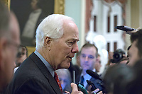 United States Senate Majority Whip John Cornyn (Republican of Texas) speaks with reporters outside the US Senate chamber in the US Capitol in Washington, DC on Friday, December 1, 2017. Photo Credit: Alex Edelman/CNP/AdMedia