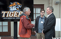 From left, Loren Brodhead '59, VP for Institutional Advancement Charlie Cardillo and Chair of the Football Action Team Vance Mueller '86 P'16.<br /> Occidental College alumni, staff and other members of the Oxy community gather in support of the football program, March 10, 2018 on Branca Patio.<br /> In January 2018 a 16-member task force of trustees, faculty, students, staff and alumni met to determine the fate of the football program in the wake of the premature end of the 2017 season. The College is moving full speed ahead with preparations for the 2018 season, led by the Football Action Team.<br /> (Photo by Marc Campos, Occidental College Photographer)
