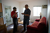 Los Angeles, California<br /> January 29, 2014<br /> <br /> Former homeless WWII veteran Ivan Bennett, 85 was placed in a VA voucher apartment a few days before he receives donated furniture. His VA case worker William Kurts is present as the furniture arrives.