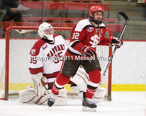 Ryan Carroll (Harvard - 35), Aaron Bogosian (St. Lawrence - 32) - The Harvard University Crimson defeated the St. Lawrence University Saints 4-3 on senior night Saturday, February 26, 2011, at Bright Hockey Center in Cambridge, Massachusetts.