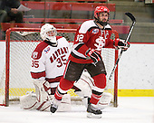 Ryan Carroll (Harvard - 35), Aaron Bogosian (St. Lawrence - 32) - The Harvard University Crimson defeated the St. Lawrence University Saints 4-3 on senior night Saturday, February 26, 2011, at Bright Hockey Center in Cambridge, Massachusetts.