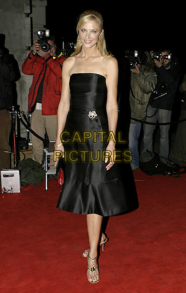 JOELY RICHARDSON.The British Fashion Awards, Victoria and Albert (V&A) Museum, London, November 2nd 2004..full length black strapless dress brooch broach.Ref: AH.www.capitalpictures.com.sales@capitalpictures.com.©Capital Pictures.