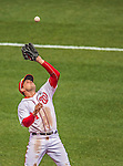 1 April 2013: Washington Nationals third baseman Ryan Zimmerman pulls in a pop foul during the Nationals' Opening Day Game against the Miami Marlins at Nationals Park in Washington, DC. The Nationals shut out the Marlins 2-0 to launch the 2013 season. Mandatory Credit: Ed Wolfstein Photo *** RAW (NEF) Image File Available ***