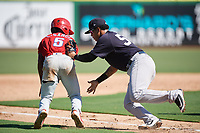 New York Yankees Nelson Gomez (50) tags Luis Garcia (5) during a Florida Instructional League game against the Philadelphia Phillies on October 12, 2018 at Spectrum Field in Clearwater, Florida.  (Mike Janes/Four Seam Images)