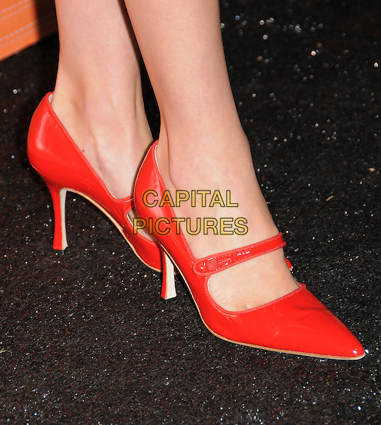JANUARY JONES' SHOES.The Rodeo Drive Walk of Style Awards Honoring Manolo Blahnik in Beverly Hills, California, USA. .September 25th, 2008.red feet heels orange mary janes pointy shoes .CAP/DVS.©Debbie VanStory/Capital Pictures.