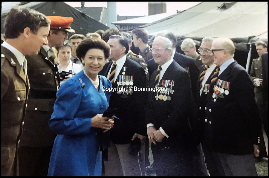 BNPS.co.uk (01202 558833)<br /> Pic: Bonningtons/BNPS<br /> <br /> Moreton (3rd right) meets Princess Margaret in 1987 with Ernest Lofthouse (2nd right) the comrade who's live he had saved by escaping to find a doctor.<br /> <br /> The amazing story of a fearless soldier who escaped from the Nazis eight times during five years as a POW including once to save a dying friend's life can be told after his bravery medals emerged for sale.<br /> <br /> Trooper Thomas Moreton, of the 19th King's Royal Hussars, was held captive at the notorious Stalag XXB in East Prussia after being captured during the Battle of France in May 1940.<br /> <br /> The tank driver was part of a defiant rearguard helping to buy time for the mass evacuation of British Expeditionary Force soldiers at Dunkirk.<br /> <br /> After being recaptured following one of his escapes, he twice went in front of a Gestapo firing squad but emerged unscathed. On another occasion, he broke out of camp to find a doctor who would tend to his gravely ill comrade as he was being denied treatment by the camp guards.