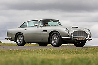BNPS.co.uk (01202 558833)<br /> Pic: Silverstone/BNPS<br /> <br /> Precious Metal - iconic DB5 that graced a Royal Mail stamp.<br /> <br /> A classic Aston Martin DB5 that featured on a limited edition commemorative stamp has sold for £607,000.<br /> <br /> The 1965 motor was hand-picked by the Royal Mail in 2013 to celebrate the best of the British car building industry.<br /> <br /> The first class stamp inspired former Top Gear host Chris Evans to buy the car later that year and he kept it for around 12 months, before it passed into the hands of a private collector.<br /> <br /> The James-Bond style GT car, which is in pristine condition, went under the hammer with Silverstone Auctions of Ashorne, Warwicks.