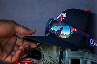 Springfield Cardinals outfielder Justin Williams (25) reaches for his cap between innings on May 19, 2019, at Arvest Ballpark in Springdale, Arkansas. (Jason Ivester/Four Seam Images)