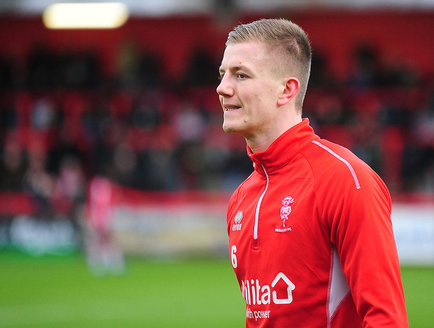 Lincoln City's Scott Wharton during the pre-match warm-up<br /> <br /> Photographer Andrew Vaughan/CameraSport<br /> <br /> The EFL Sky Bet League Two - Stevenage v Lincoln City - Saturday 8th December 2018 - The Lamex Stadium - Stevenage<br /> <br /> World Copyright © 2018 CameraSport. All rights reserved. 43 Linden Ave. Countesthorpe. Leicester. England. LE8 5PG - Tel: +44 (0) 116 277 4147 - admin@camerasport.com - www.camerasport.com