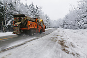 Snow removal after a snow storm along the Kancamagus Highway (route 112) in the White Mountains, New Hampshire USA. The Kancamagus Highway is one of New England's scenic byways.