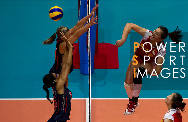 22 August 2010, Hong Kong, China ---  China's Wang Yimei spikes against USA during their volleyball game on the last day of the FIVB World Grand Prix Pool G at the Hong Kong Coliseum stadium. Photo by Victor Fraile --- Image by © Victor Fraile