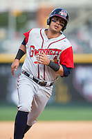 Rio Ruiz (24) of the Gwinnett Braves takes off for third base against the Charlotte Knights at BB&T BallPark on May 22, 2016 in Charlotte, North Carolina.  The Knights defeated the Braves 9-8 in 11 innings.  (Brian Westerholt/Four Seam Images)